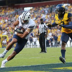 Brigham Young Cougars wide receiver Moroni Laulu-Pututau (1) makes a touchdown catch ahead of West Virginia Mountaineers safety Jeremy Tyler (2) at FedEx Field in Landover, Maryland on Saturday, Sept. 24, 2016.