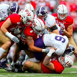 Garrett Rand (#92) leads a team tackle. Rand had two tackles and a QB hurry against the Wildcats.