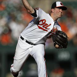 Baltimore Orioles starting pitcher Steve Johnson throws to the Toronto Blue Jays in the second inning of the first baseball game of a doubleheader in Baltimore, Monday, Sept. 24, 2012.