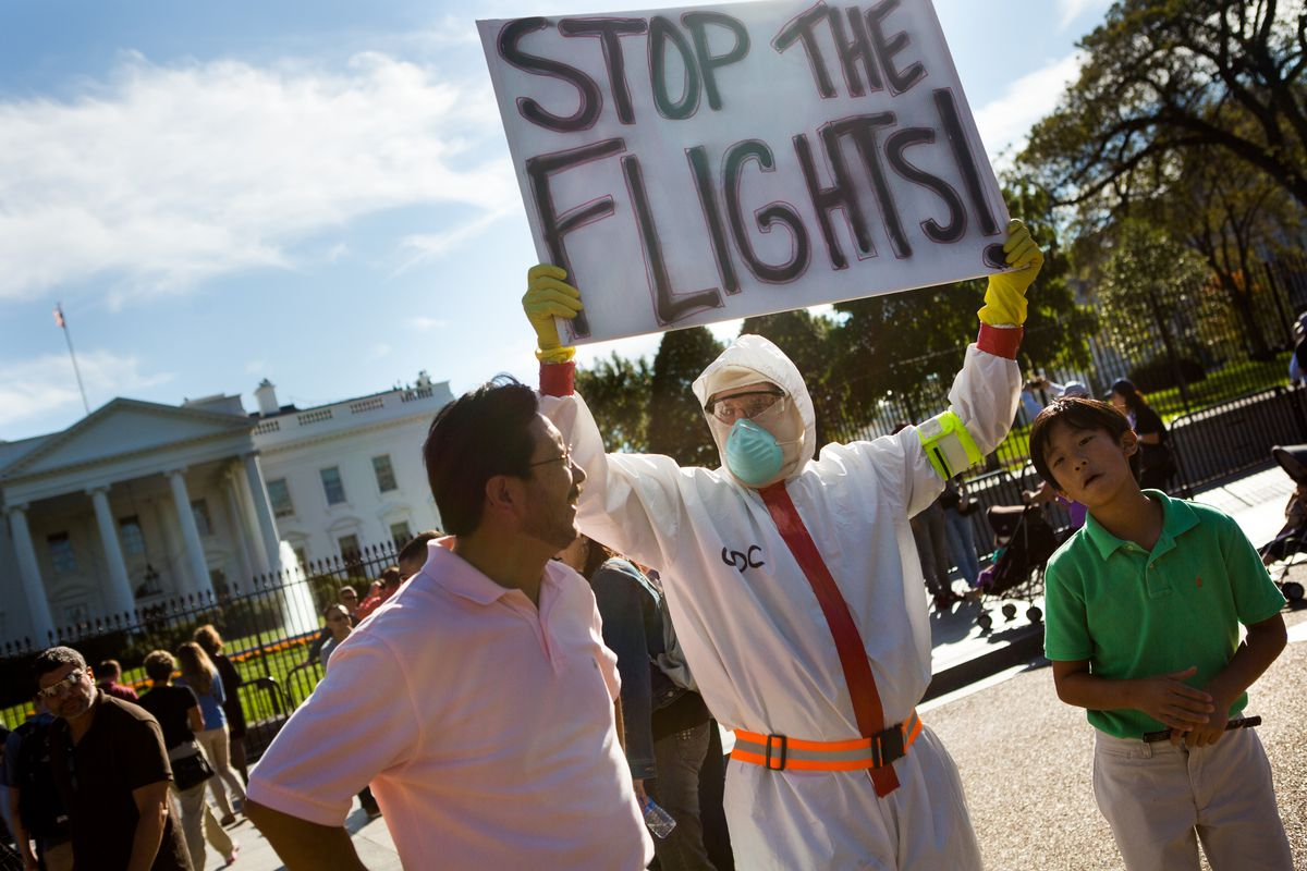Protesters outside the White House calling for a travel ban from the Ebola hot zone.