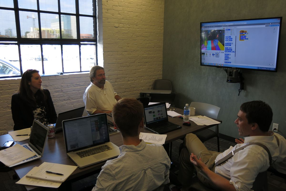 Educators from RePublic Schools, Bailey STEM, and Apollo Middle Prep go over a computer programming curriculum at the Nashville Entrepreneur Center.