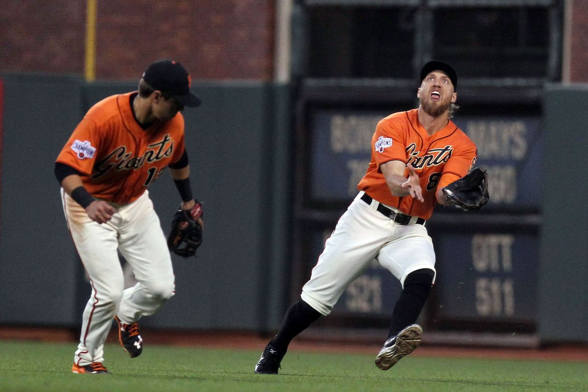 Pictured: Hunter Pence of the San Francisco Giants makes an invisible offering to the Shutout Gods.