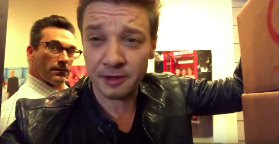 Jeremy Renner with Jon Hamm in the background