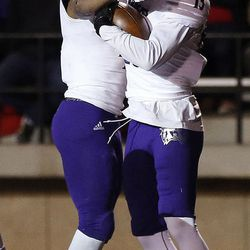 Weber State Wildcats wide receiver Drew Batchelor, right, and running back Kevin Smith celebrate a touchdown against the Southern Utah Thunderbirds during NCAA football in Cedar City on Saturday, Dec. 2, 2017.