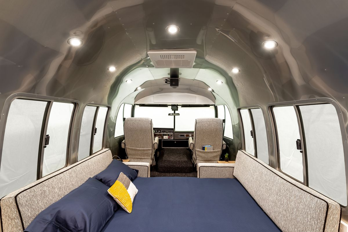 Two of the sofas in the Airstream transform into a sleeping space for two.