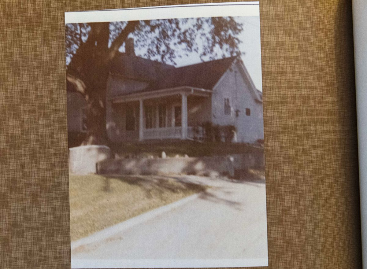 A picture of Edith Renfrow Smith's childhood home in Grinnell, Iowa, in a family photo album. She showed the album to a reporter at her home in Ravenswood on Friday, June 18, 2021.