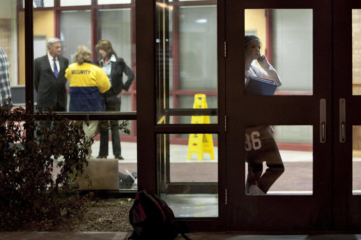 FILE - In this Jan. 7, 2011, file photo an  unidentified student is framed by a door following a fatal shooting at Millard South high school in Omaha, Neb. Nebraska lawmakers will evaluate  Wednesday, Feb. 16, 2011, whether allowing teachers and other sch