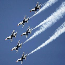 The Air Force's Thunderbirds perform as thousands turn out for the Hill Air Force Base air show  Saturday.