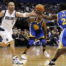 Dallas Mavericks' Jason Kidd (2) and Golden State Warriors' Charles Jenkins (22) reach out for a loose ball as Dorell Wright (1) watches in the first half of an NBA basketball game Friday, April 20, 2012, in Dallas.