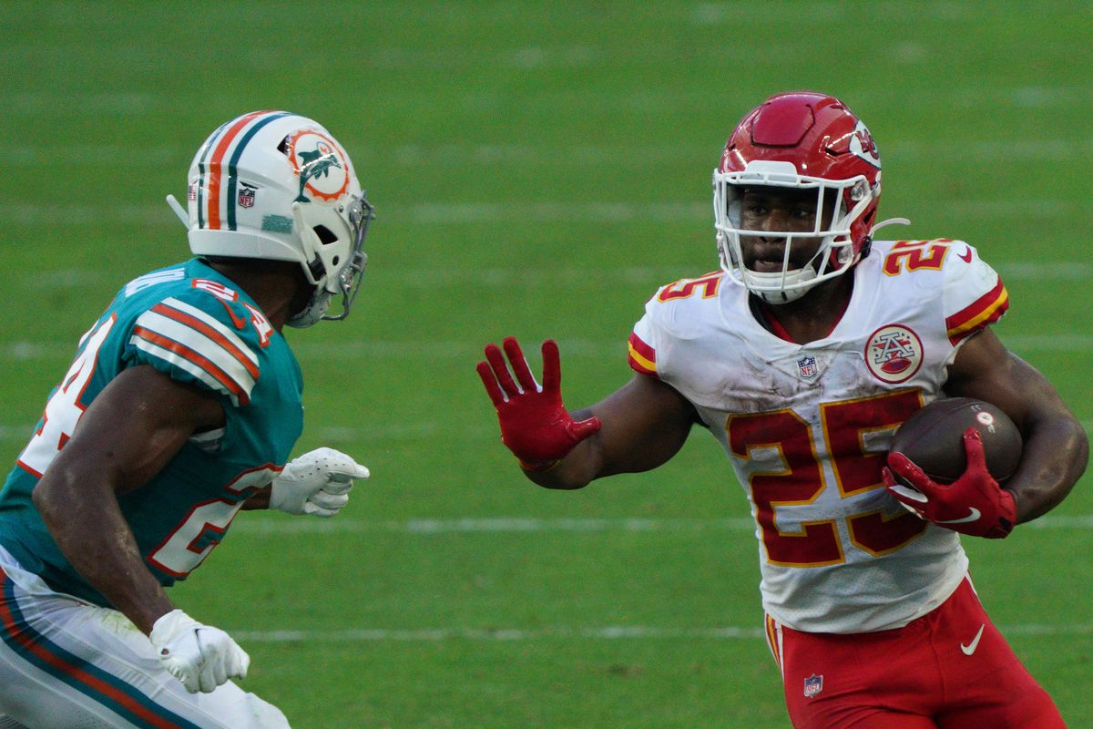 Clyde Edwards-Helaire #25 of the Kansas City Chiefs runs with the ball against the Miami Dolphins at Hard Rock Stadium on December 13, 2020 in Miami Gardens, Florida.