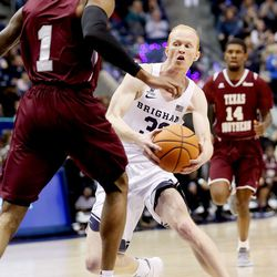 Brigham Young Cougars guard TJ Haws (30) fakes Texas Southern Tigers guard Donte Clark (1) on his way in for a basket as BYU and Texas Southern play an NCAA basketball game in Provo at the Marriott Center on Saturday, Dec. 23, 2017. BYU won 73-52.