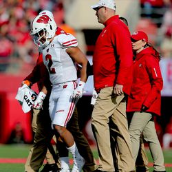 Reggie Pearson JR leaves the field of play after sustaining an injury. Pearson would return and lead the team in tackles with 10 including a 4th down goal line stand to finish Nebraska's final effort.