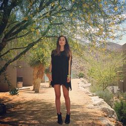 """Rumi of <a href=""""http://www.fashiontoast.com/"""">Fashion Toast</a> is wearing a BCBG dress and Anine Bing boots. Photo via <a href=""""http://instagram.com/p/YDeU3Gg7vO/"""">RumiNeely</a>/Instagram."""