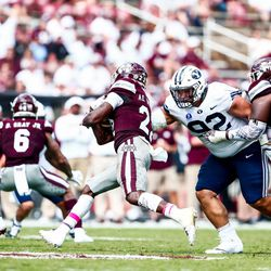 BYU defensive tackle Handsome Tanielu (92) tries to tackle Mississippi State running back Aeris Williams at Davis Wade Stadium in Starkville, Miss., on Saturday, Oct. 14, 2017.