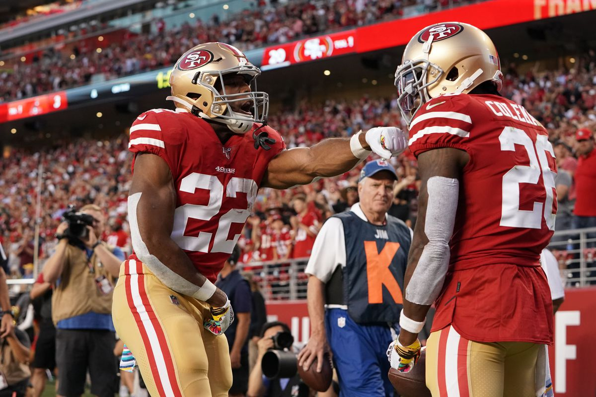 San Francisco 49ers running back Tevin Coleman is congratulated by running back Matt Breida after rushing for a touchdown against the Cleveland Browns in the second quarter at Levi's Stadium.