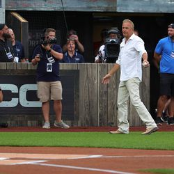 Actor Kevin Costner walks onto the field prior to a game between the Chicago White Sox and the New York Yankees.