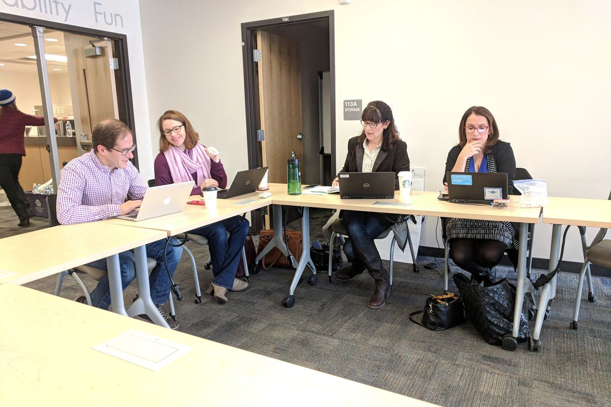 Denver Public Schools Chief Financial Officer Mark Ferrandino, left, general counsel Michelle Berge, Chief Human Resources Officer Debbie Hearty, and Superintendent Susana Cordova sit at the bargaining table Sunday without any union counterparts.