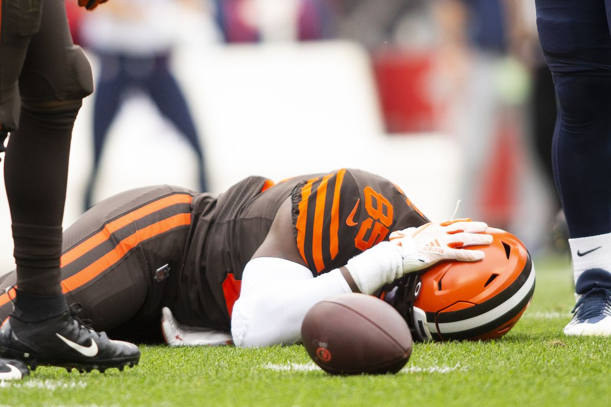 Cleveland Browns tight end David Njoku lays on the ground following a hit to the head by the Tennessee Titans during the second quarter at FirstEnergy Stadium.