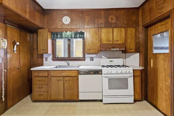 An older kitchen with a single counter.