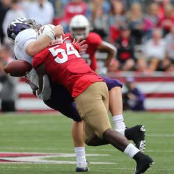 Chris Orr separates the NU QB from the ball...