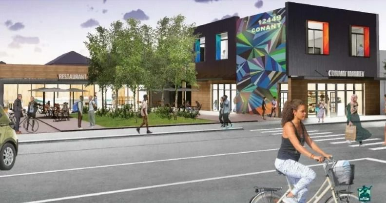 Rendering of an active street with cyclists and pedestrians in front of two new buildings and a plaza with tables and chairs in the Banglatown development in Detroit.