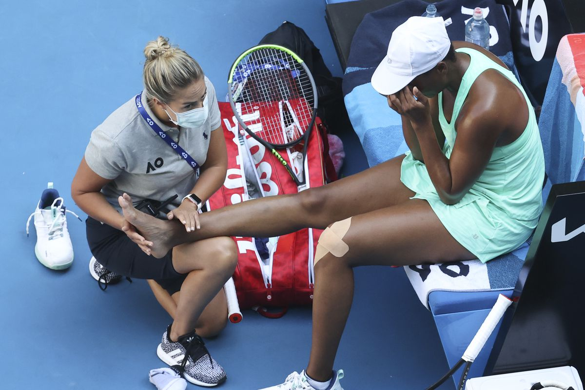 Venus Williams receives treatment to leg injuries during her second round match against Sara Errani at the Australian Open. Williams lost her match 6-1, 6-0.