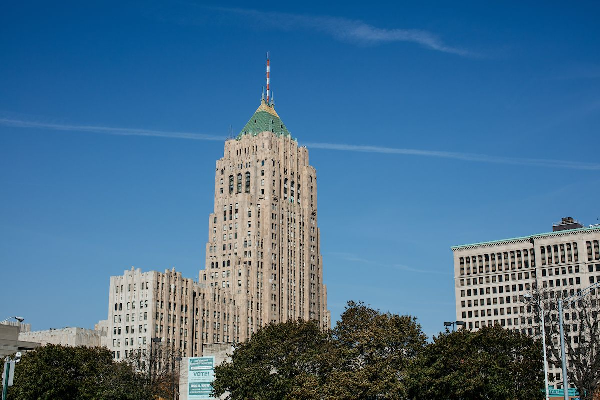 The exterior of the Fisher Building in Detroit. The building has a tall tower with a green top.