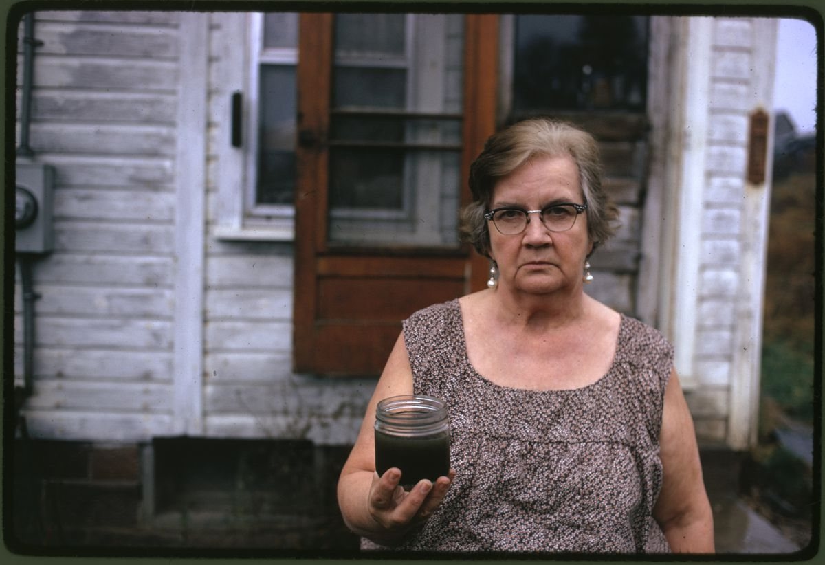Verge caption:  A woman holds a jar of undrinkable water from her well in Ohio in 1973. She filed a damage suit against the Hanna Coal Company, which owned the land around her house. Photo by Erik Calonius / US National Archives. From EPA's Documerica project.