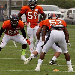 Denver Broncos LB Von Miller gets ready to move in on teammate Steven Johnson