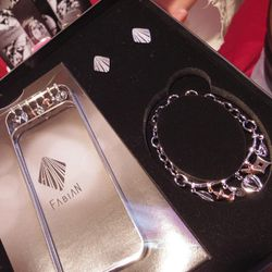 """Korean tech accessories brand <a href=""""http://www.fabianstar.com"""">Fabian</a> also doled out iPhone cases with matching charm bracelets for the ladies and cufflinks for the men ($800)."""