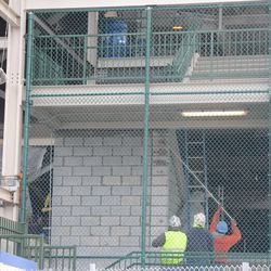 2:22 p.m. Left-field corner staircase being enclosed -