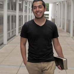 """In this photo taken July 26, 2012, recent Ohio State University graduate Erik Santamaria sits on a campus library stairway in Columbus, Ohio. He's 30, between jobs, with $50,000 in student debt, and no clear sense what the future holds. But Erik Santamaria, Ohio-born son of Salvadorans, has a pretty awesome attitude about his country, his life and the world of possibilities. """"Maybe things won't work out the way I want,"""" he offers. """"But, boy, I sure can't complain about how things have worked out so far."""""""