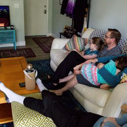 Maya Bennett, 10, Edward Castro Bennett, Silvia Castro, Luna Thomas, 6, and Gavin Bennett, 15, watch the Sunday morning session of the 190th Annual General Conference of The Church of Jesus Christ of Latter-day Saints in their Murray home on Sunday, April 5, 2020. The couple were recently baptized on Feb. 7 and planned to attend a session of conference at the Conference Center before the COVID-19 pandemic prevented the mass gatherings.