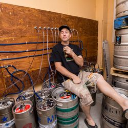 Owner and brewmaster Scott Wood taking a break with a beer on top of beer