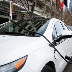 A Nissan LEAF charges in downtown Salt Lake City on Wednesday, Feb. 8, 2017. HB29, a legislative proposal to keep electric vehicle tax credits alive but phase them out entirely six years from now remains a work in progress, with negotiations continuing between its sponsor and other lawmakers.