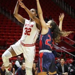.Utah Utes forward Tanaeya Boclair (32) shoots around the outstretched arm of Saint Mary's guard Emily Codding (23) as Utah hosts Saint Mary's at the Huntsman Center in Salt Lake on Saturday, Dec. 2, 2017.