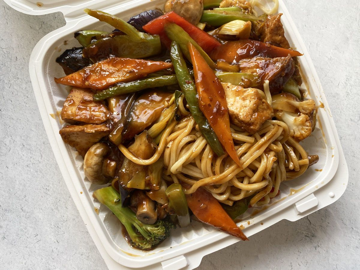 A photo of veggie dan dan noodles in a takeout container from Uncle Tsang's Kitchen