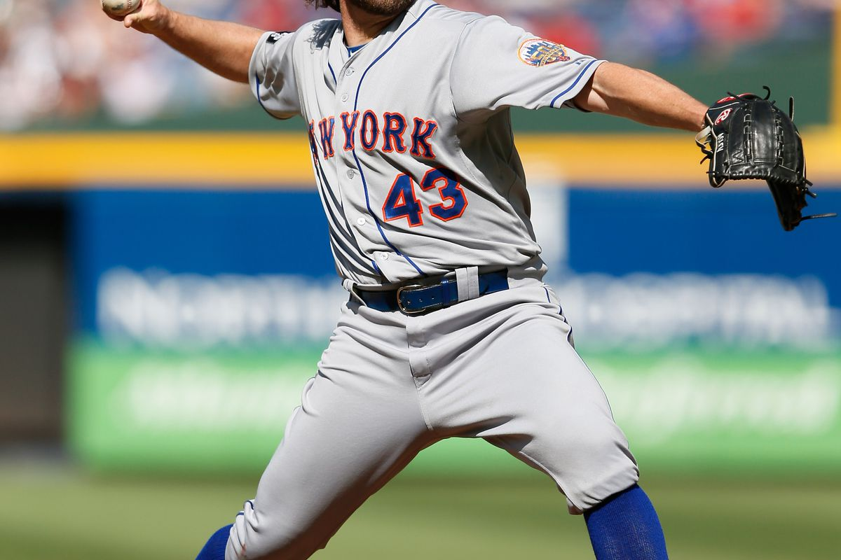 ATLANTA, GA - JULY 14:  R.A. Dickey #43 of the New York Mets pitches to the Atlanta Braves at Turner Field on July 14, 2012 in Atlanta, Georgia.  (Photo by Kevin C. Cox/Getty Images)