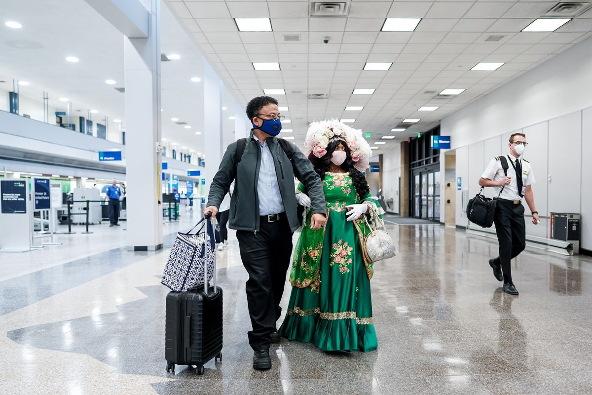 Michael Springs and his wife, Mama Goose, her legal name, walk through Salt Lake City International Airport as they travel home to Houston on Thursday, April 30, 2020. Like airports all over the world, Salt Lake's airport has seen air traffic plummet due to the COVID-19 pandemic.