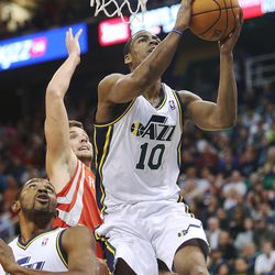 Utah Jazz's point guard Alec Burks (10) flies in for a shot as the Jazz and the Rockets play Saturday, Nov. 2, 2013 in EnergySolutions arena.
