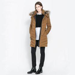 "<span class=""credit""><b>Zara</b> Herringbone Puffer Jacket, <a href=""http://www.zara.com/us/en/woman/coats/herringbone-puffer-jacket-c437584p1295961.html"">$139.99</a> (originally $189)</span><p>"