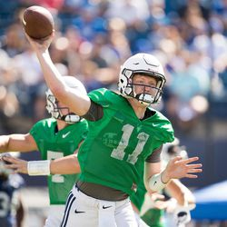 BYU quarterback Joe Critchlow throws a pass during fall camp in Provo.