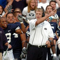 BYU coach Bronco Mendenhall calls for a TCU TD to be reviewed in OT, but the outcome wasn't changed.