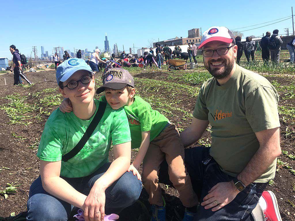 Pamela Bergson with son, Walker, and husband, Josh Emmons, volunteered Sunday at Chicago FarmWorks.   Mitch Dudek/Sun-Times