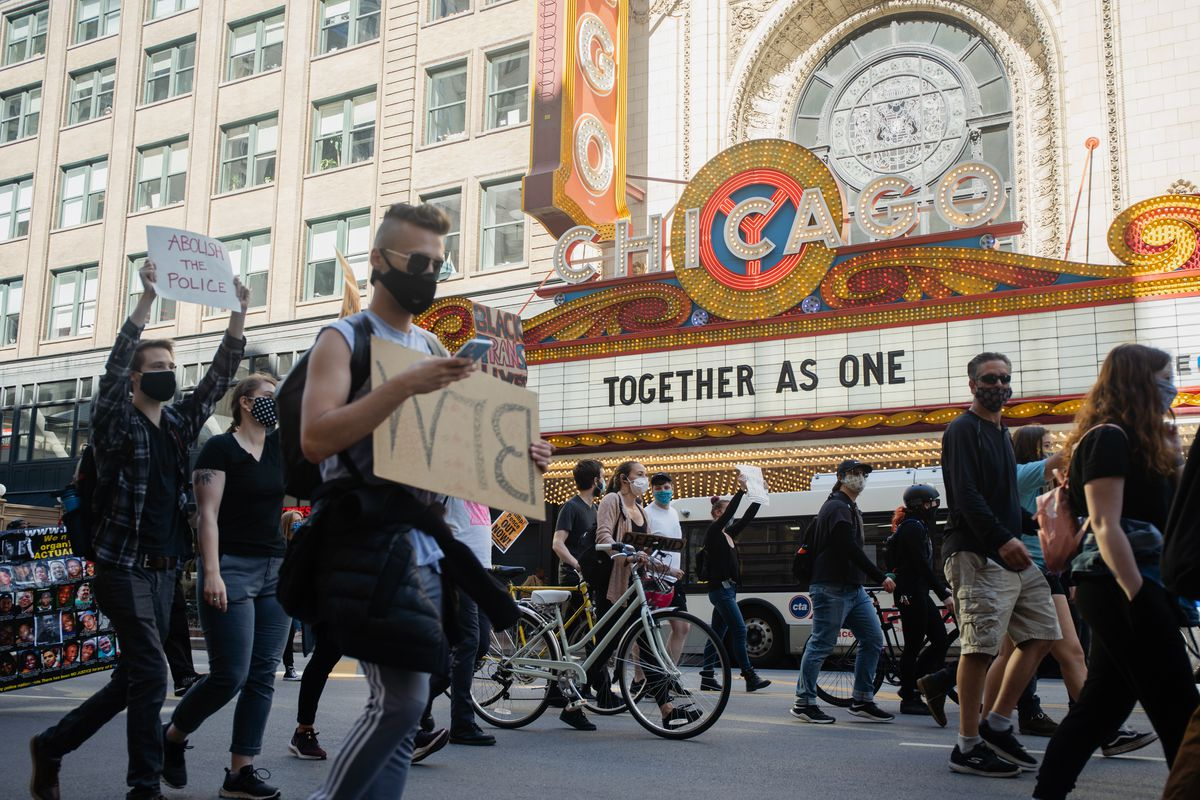 Hundreds of protesters march Saturday along State Street.