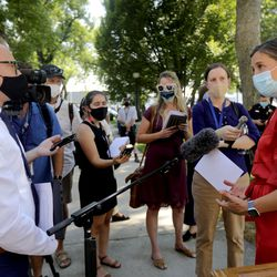 Reporters talk to Salt Lake City Mayor Erin Mendenhall, right, after a press conference about updates to the city's police policies — including de-escalation efforts, use of force, body cameras and consent to search — outside of the City-County Building in Salt Lake City on Monday, Aug. 3, 2020.