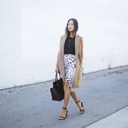 """Aimee of <a href=""""http://www.songofstyle.com""""target=""""_blank"""">Song of Style</a> is wearing a Mango sleeveless coat, a <a href=""""http://www.shopbop.com/kinetic-jersey-tank-helmut-lang/vp/v=1/1528321195.htm?folderID=2534374302060705&fm=other-shopbysize-viewal"""