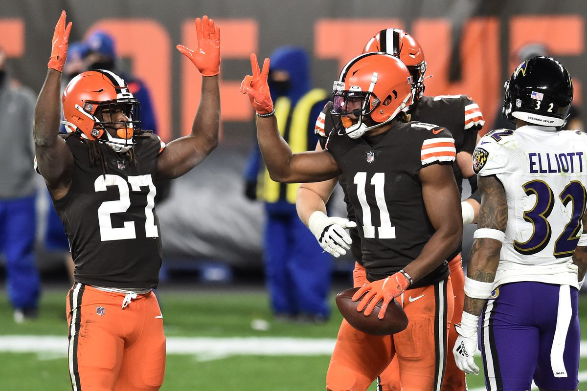 Cleveland Browns running back Kareem Hunt (27) and wide receiver Donovan Peoples-Jones (11) celebrate after Peoples-Jones caught a two-point conversion during the second half against the Baltimore Ravens at FirstEnergy Stadium.