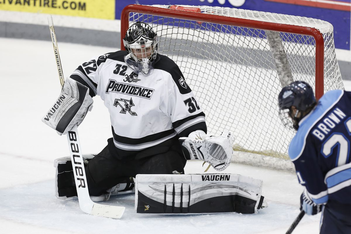 Providence sophomore Jon Gillies stops Maine forward Cam Brown who had a good chance on the backdoor in the second period.