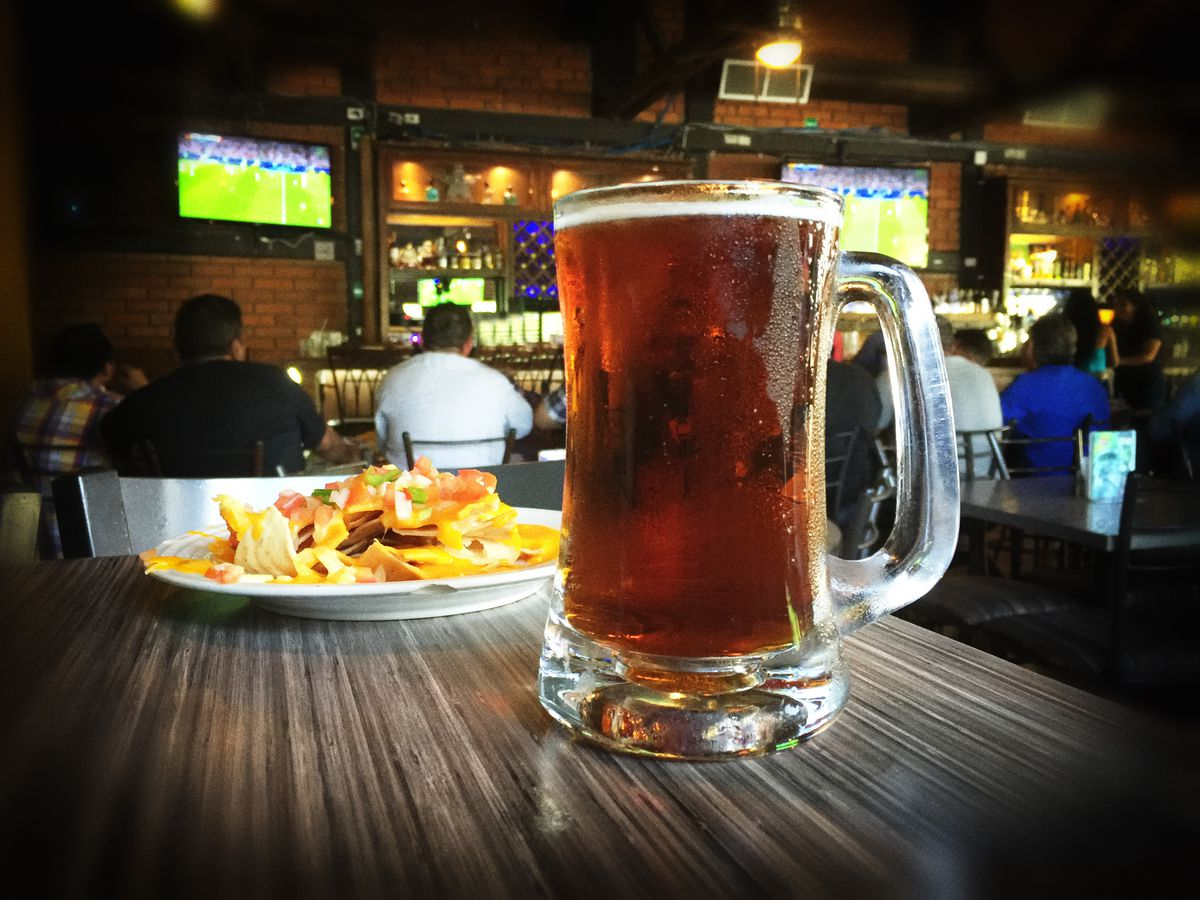 Beer and nachos at a sports bar